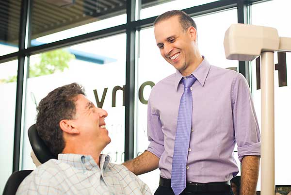 Dr. da Costa, Dentist in Beaverton, working with an actual patient.