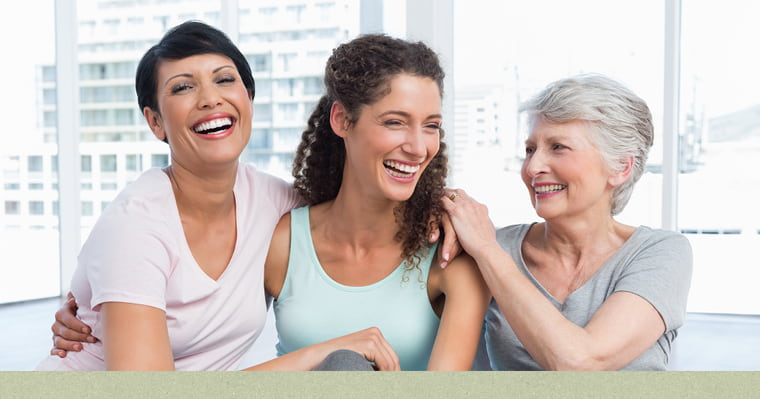 Three generations of women representing the different stages women's hormones and oral health are increasingly related